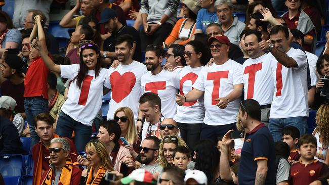 """Supporters wear t-shirt reading """"I love Totti""""."""