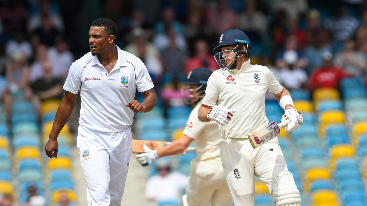 Joe Root (R) of England get runs off Shannon Gabriel (L) of West Indies.