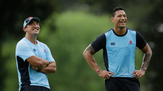 Waratahs coach Daryl Gibson and Israel Folau smile during a training session.