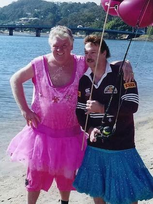 Johnny Veen and Greg Doolan fishing at Currumbin in tutus after Doolan lost a State of Origin bet. Picture: Supplied.