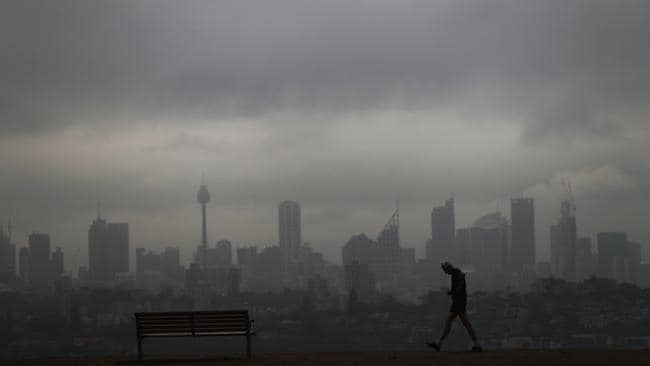 Sydney CBD waits for rain as the western suburbs get storms. Picture: John Grainger