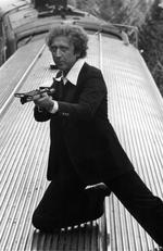 Gene Wilder on top of train with gun in a scene from the film 'Silver Streak', 1976. Picture: 20th Century-Fox/Getty Images