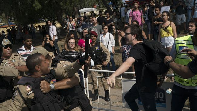 A supporter of Brazil's former monarchy scuffles with municipal guards outside the National Museum. Picture: AP.