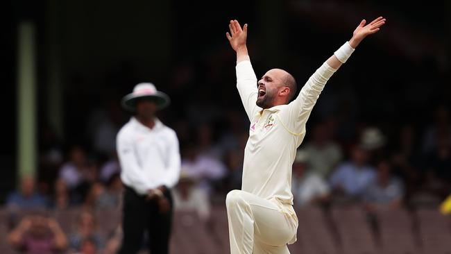 Nathan Lyon appeals successfully for the wicket of Moeen Ali — again.
