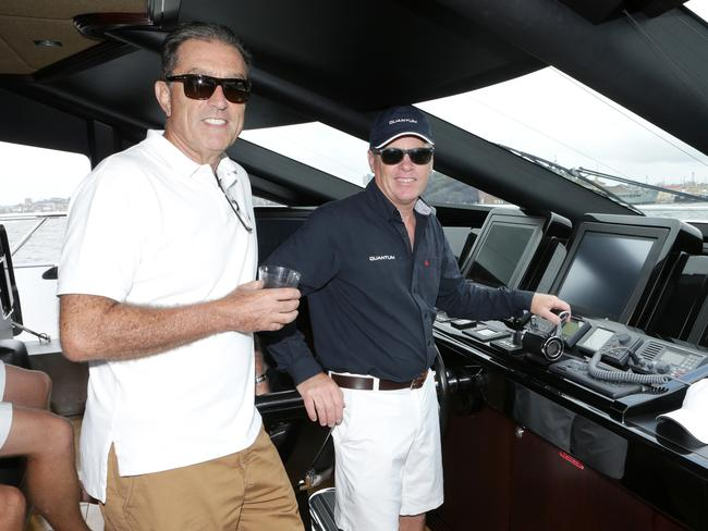 Owner Stephen Burcher and Captain Glen Gray on his boat, Quantum, in Sydney Harbour several years ago.