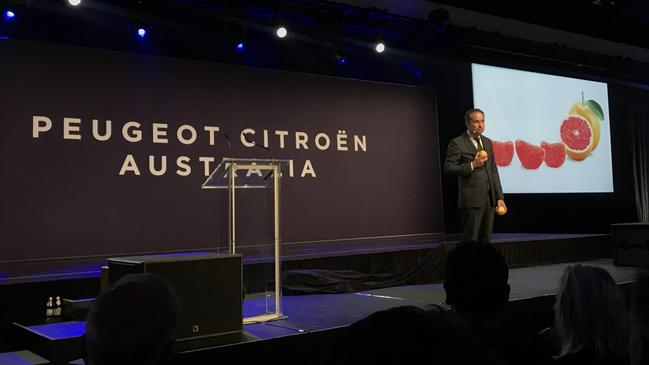Peugeot Citroen Australia managing director Ben Farlow on stage with grapefruit.