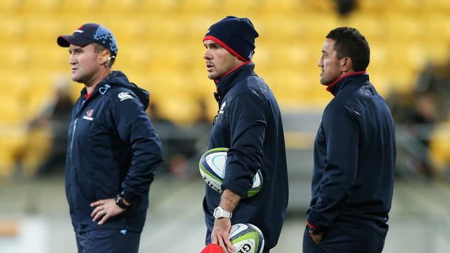 Assistant coaches Chris Malone and Nathan Grey and head coach Daryl Gibson of the Waratahs.