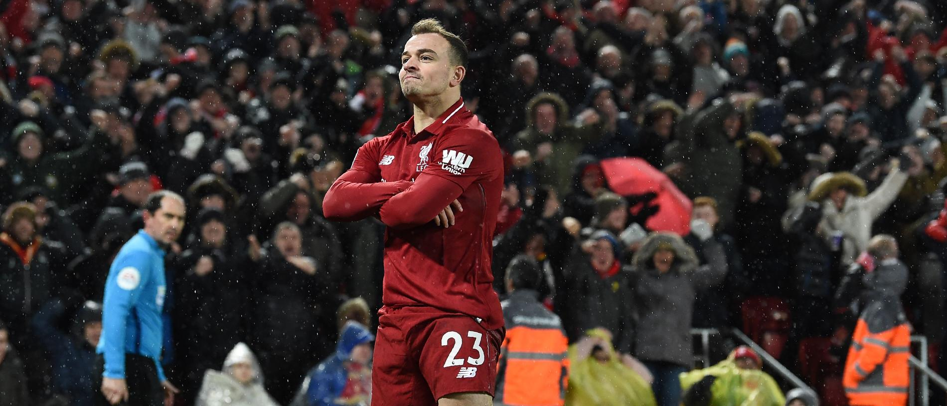 Liverpool's Swiss midfielder Xherdan Shaqiri celebrates after scoring their second goal during the English Premier League football match between Liverpool and Manchester United at Anfield in Liverpool, north west England on December 16, 2018. (Photo by Paul ELLIS / AFP) / RESTRICTED TO EDITORIAL USE. No use with unauthorized audio, video, data, fixture lists, club/league logos or 'live' services. Online in-match use limited to 120 images. An additional 40 images may be used in extra time. No video emulation. Social media in-match use limited to 120 images. An additional 40 images may be used in extra time. No use in betting publications, games or single club/league/player publications. /