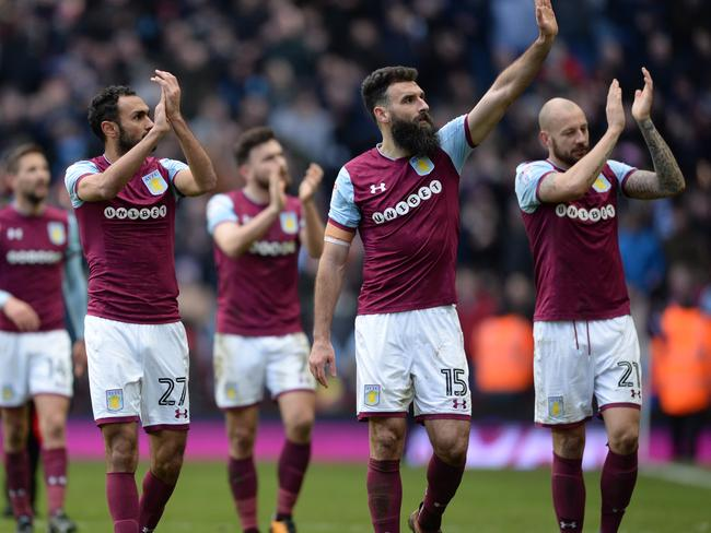 Aston Villa players clap the fans after the match.