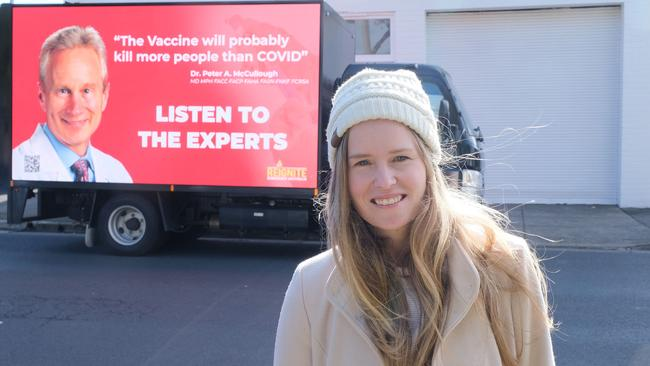 Monica Smit posed in front of one of her anti-vax billboards in Geelong. Picture: Mark Wilson