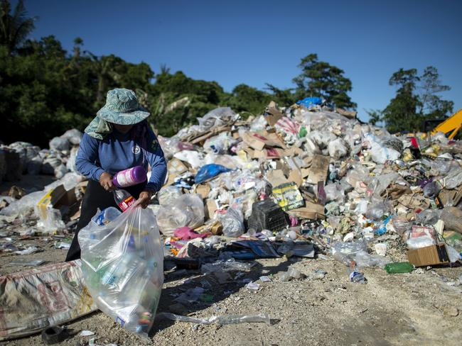 A volunteer collects plastic bottles at a Boracay dump site on April 25, a day before Boracay was closed. Picture: AFP/Noel Celis