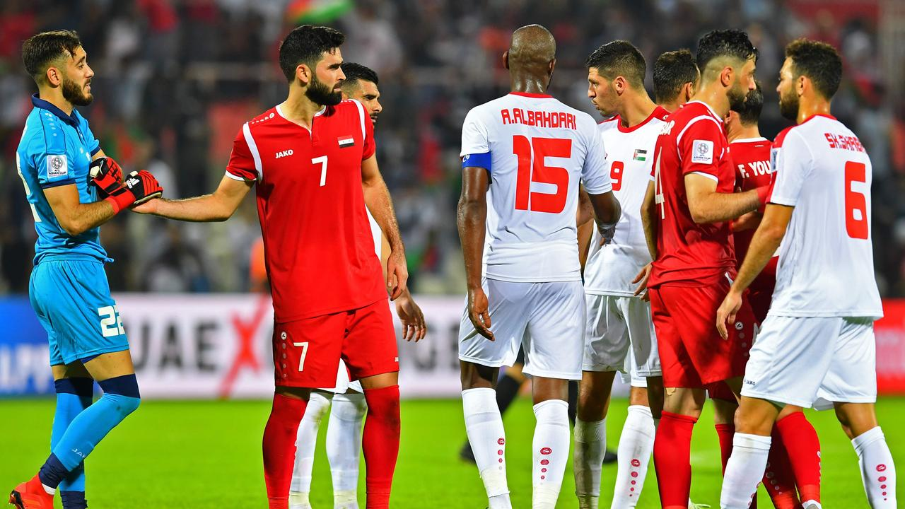 Syria and Palestine players. (Photo by Giuseppe CACACE / AFP)