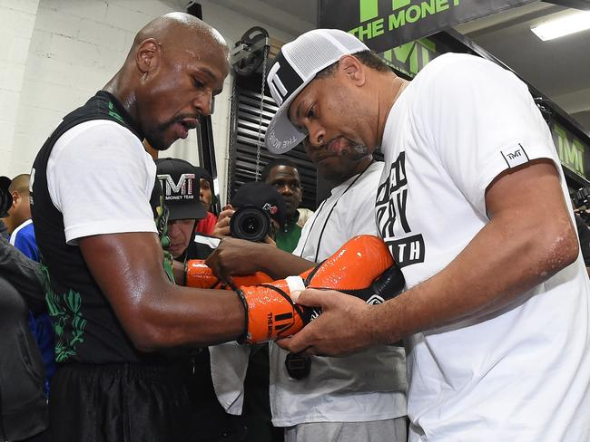 Bob Ware is responsible for taping Mayweather's hands and gloves.