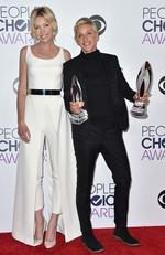 Portia de Rossi poses in the press room with Ellen DeGeneres, winner of the awards for favorite daytime TV host and favorite humanitarian, at the People's Choice Awards. Picture: AP