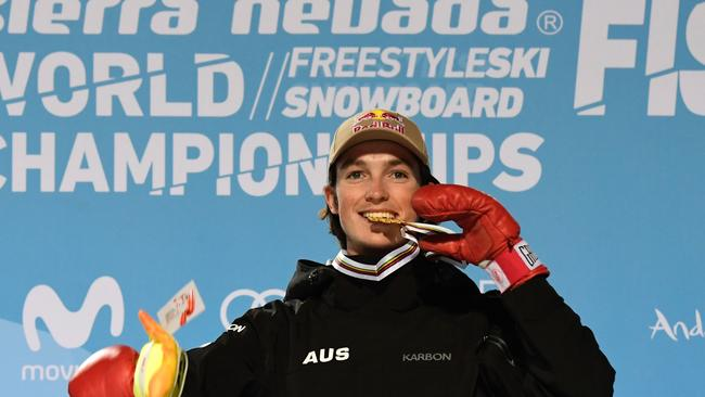 James poses with his gold medal on the podium of the men's halfpipe final in the FIS Snowboard and Freestyle Ski World Championships 2017.