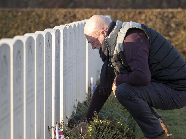 Tony and Debbie Sullivan, of Glenelg in Adelaide visited his grave for the first time at Crucifix Corner Cemetery in Villers-Bretonneux. Picture: Ella Pellegrini