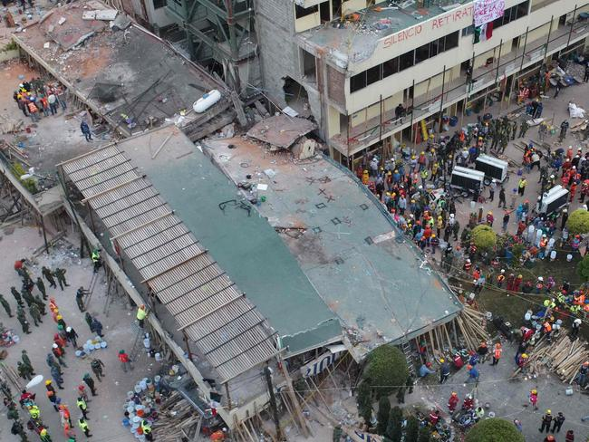 Mexican rescue teams look for people trapped in the rubble at the Enrique Rebsamen elementary school in Mexico City. Picture: AFP