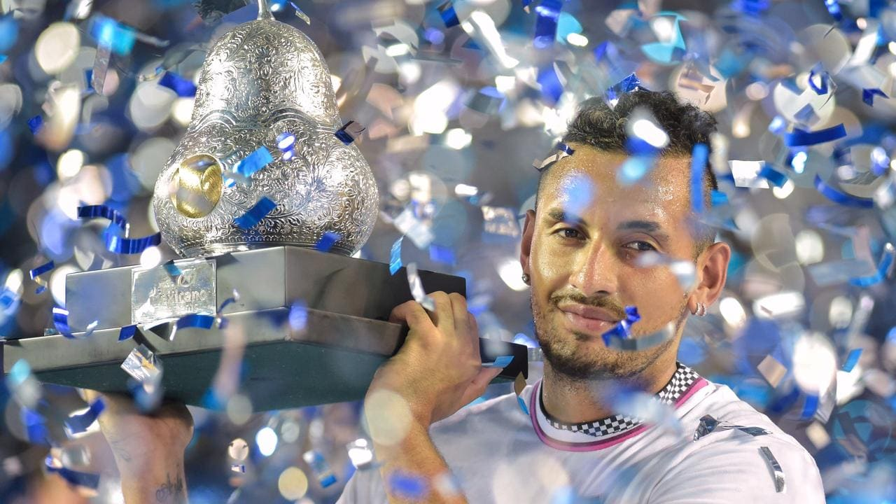 Kyrgios with the Mexican Open pear trophy.