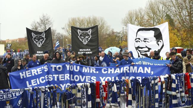 Fans on a memorial walk for those who lost their lives in the Leicester City helicopter crash