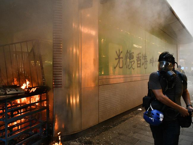 Smoke billows from an exit of the Central MTR underground metro station after it was set alight during a protest in Hong Kong. Picture: AFP