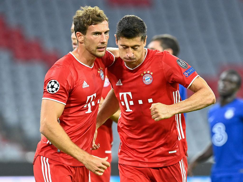 Bayern Munich's Polish forward Robert Lewandowski (R) celebrates scoring his team's first goal during the UEFA Champions League, second-leg round of 16, football match FC Bayern Munich v FC Chelsea in Munich, southern Germany on August 8, 2020. (Photo by Tobias SCHWARZ / AFP)
