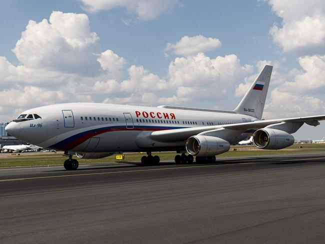 The plane carrying Russian President Vladimir Putin lands at the Helsinki-Vantaa Airport in Helsinki.
