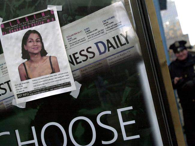 A poster of Dr Sneha Ann Philip, who has been missing since the day before the September 11 terrorist attacks, is displayed on a phone booth near the World Trade Center work site. Picture: Todd Maisel/NY Daily News Archive via Getty Images