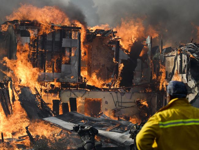 A wildfire consumes a home in Ventura. Picture: AP