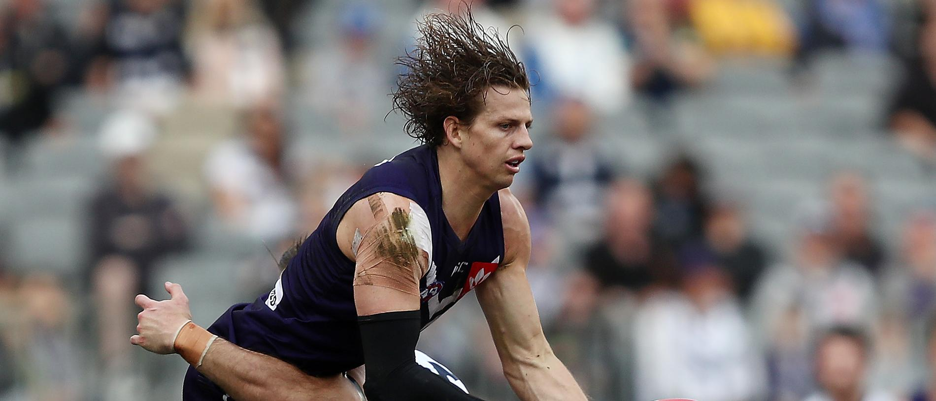 Nat Fyfe of the Dockers is tackled by Tom Hawkins of the Cats during the Round 20 AFL match between the Fremantle Dockers and the Geelong Cats at Optus Stadium in Perth, Saturday, August 3, 2019.  (AAP Image/Gary Day) NO ARCHIVING, EDITORIAL USE ONLY