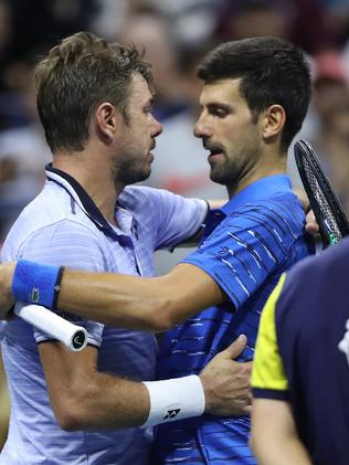 Wawrinka and Djokovic embrace. Picture: Matthew Stockman/Getty Images/AFP