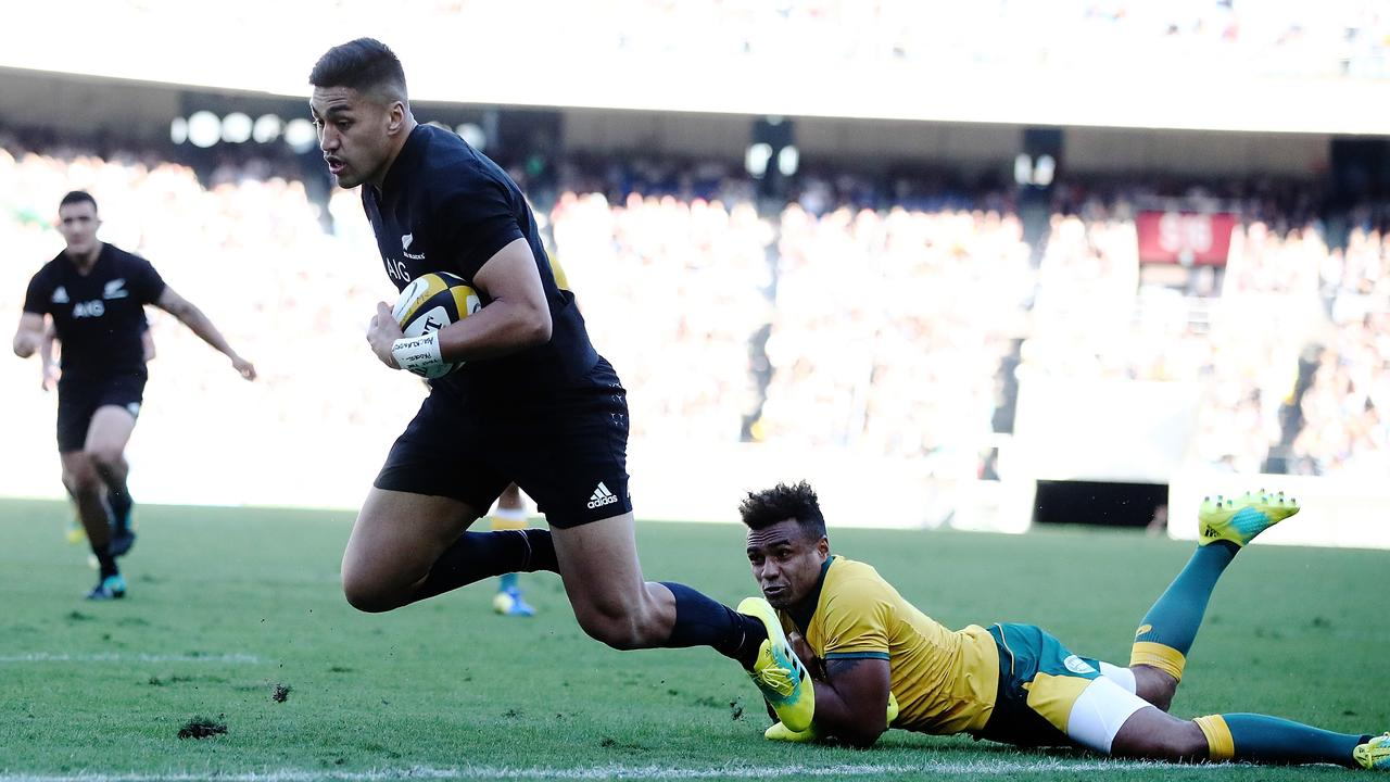 Rieko Ioane of the All Blacks breaks the tackle of Will Genia of the Wallabies.