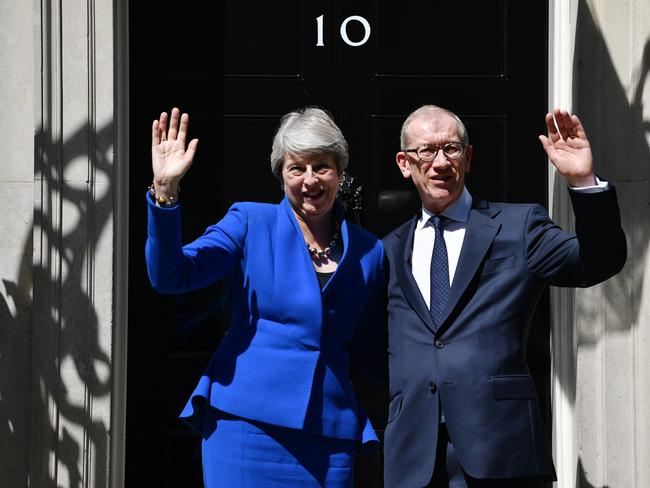 Outgoing Prime Minister Theresa May waves to the world's media beside husband Philip May from outside 10 Downing Street. Picture: Jeff J Mitchell/Getty Images)
