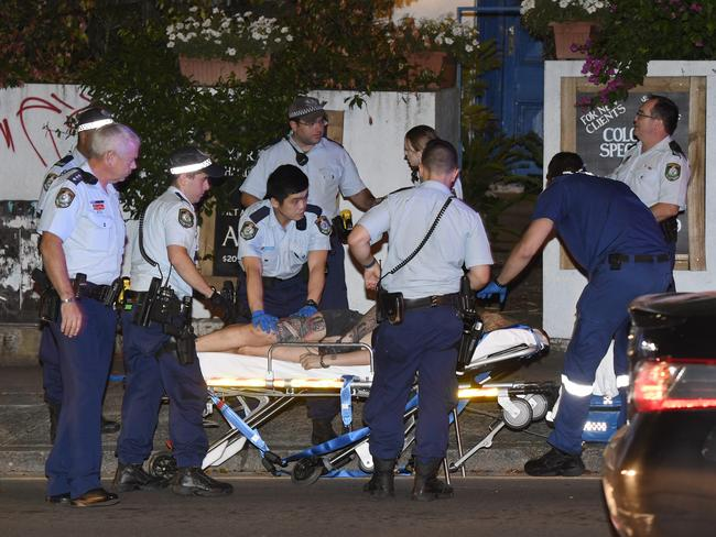Paramedics take Amati away from the scene and off to hospital. Picture: Gordon McComiskie