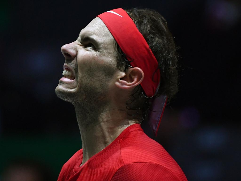 Spain's Rafael Nadal reacts to missing a point against Canada's Denis Shapovalov during the final singles tennis match between Canada and Spain at the Davis Cup Madrid Finals 2019 in Madrid on November 24, 2019. (Photo by GABRIEL BOUYS / AFP)