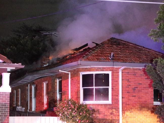 A male has died after running back into his burning house after rescuing his mother. Picture: Bill Hearne