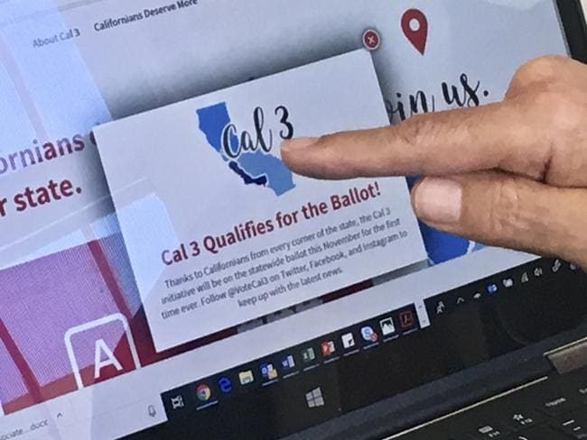 Tim Draper points to a computer screen at his offices showing that an initiative to split California into three states qualified for the ballot. Picture: Haven Daley/AP