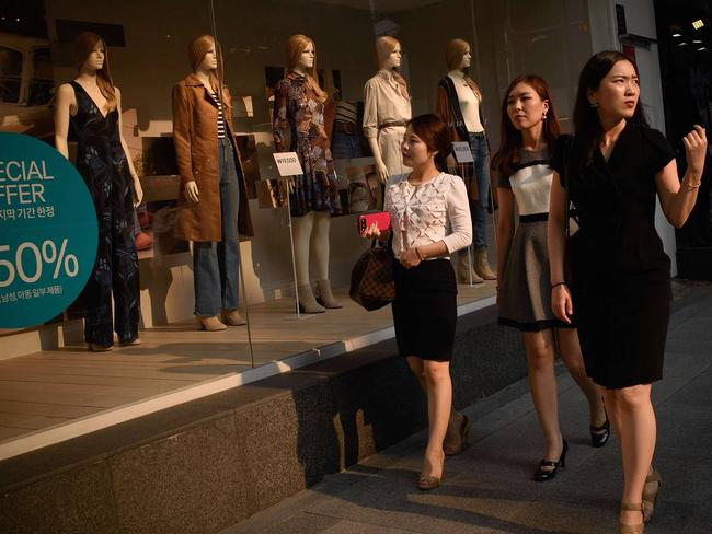 A different world: Women in South Korea enjoy the sales. Picture: AFP/Getty Images