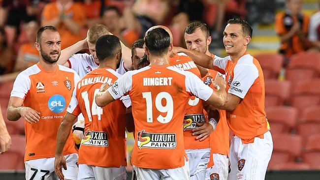 Brisbane Roar players celebrate. (AAP Image/Dan Peled)