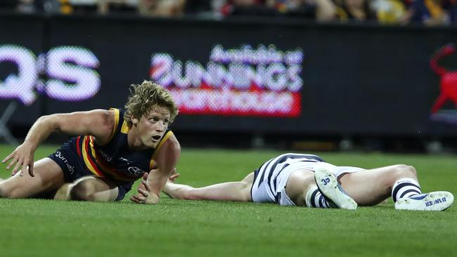 Rory Sloane clashes with Patrick Dangerfield. Picture Sarah Reed