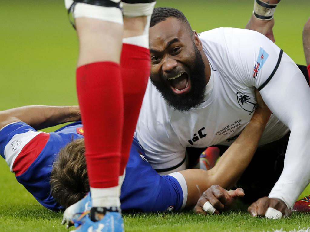 FILE - In this Nov. 24, 2018, file photo, Fiji's Semi Radradra celebrates after scoring a try against France during a rugby international between France and Fiji at Stade de France in Paris. Teams from the Pacific islands are immensely popular around the world and their appearances at the Rugby World Cup are likely to attract large and admiring crowds. But an appreciative welcome won't disguise the fact that the Pacific nations begin the tournament under a considerable handicap. (AP Photo/Christophe Ena, File)