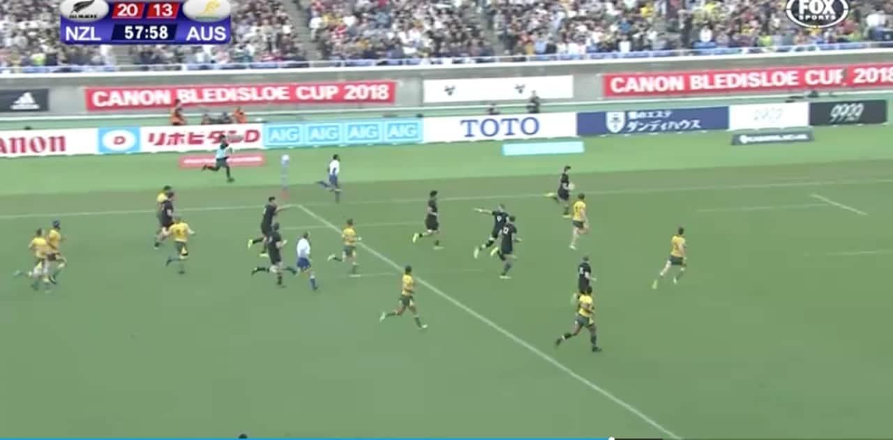 Beauden Barrett runs away to score as TJ Perenara points back at Rieko Ioane. Mission accomplished.