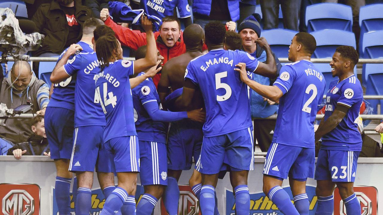 Cardiff City's Sol Bamba, center, pretty clearly took his shirt off during celebrations!