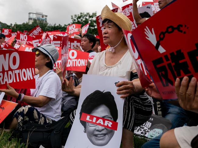 Protesters hold placards and shout slogans during a rally in Hong Kong. Picture: Getty