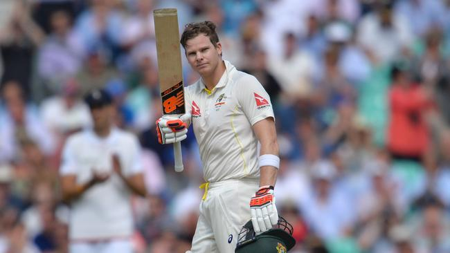 Steve Smith raises his bat after reaching triple figures for the second time at The Oval.