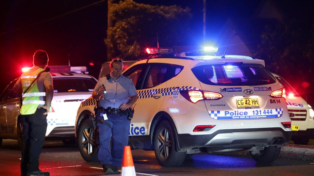 Woman dies after being hit by a truck while crossing the road in