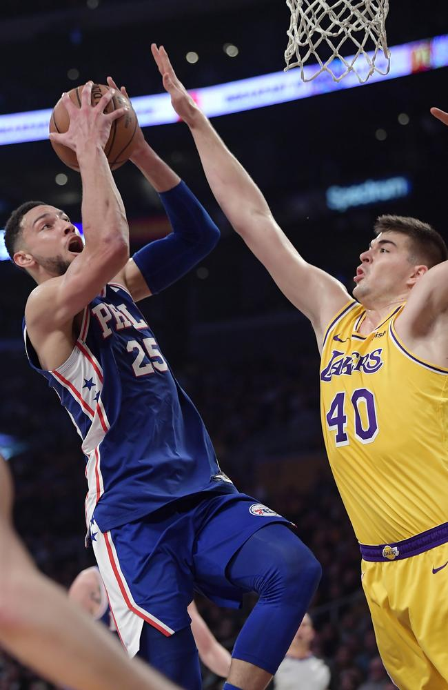 What he does best! Philadelphia 76ers guard Ben Simmons, left, shoots as Los Angeles Lakers centre Ivica Zubac defends. Picture: AP Photo/Mark J. Terrill