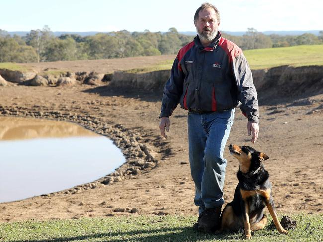 Dairy Farmer Brett Hayter with his dog Bobby at their Werombi property on the outskirts of Sydney. Picture: Tim Hunter.