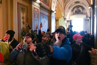 TOPSHOT - Supporters of US President Donald Trump protest inside the US Capitol on January 6, 2021, in Washington, DC. - Demonstrators breeched security and entered the Capitol as Congress debated the a 2020 presidential election Electoral Vote Certification. (Photo by ROBERTO SCHMIDT / AFP)