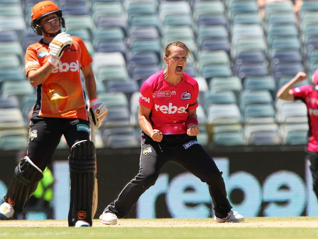 Sarah Aley celebrates one of four wickets she took during the WBBL final this year, which the Sydney Sixers won by seven runs. Pic: AAP