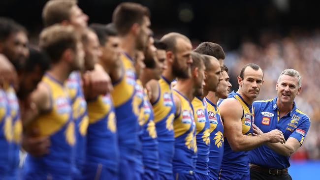Adam Simpson talks to his players before the national anthem.
